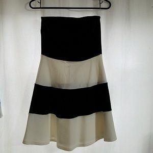 Black and white strapless dress.